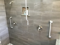pebble stone inlay on niche. 3 niches total in shower. pebble stones also used for the shower floor.